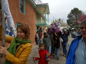 Rivera Sun, left and Kimo Ward, right of Love-In-Action Taos lead the Community Parade down Bent St. in Taos, NM during the Global Climate Convergence.
