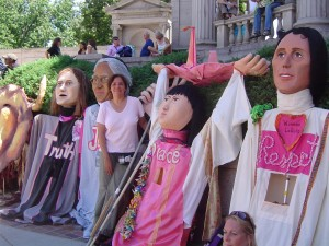 CodePink Taos is bringing these 5 Giant Puppets to the Parade … and looking for 5 strong backs to wear them!