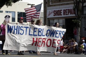 Supporters of whistleblowers march in Santa Monica's seventh annual Fourth of July parade in Santa Monica, California