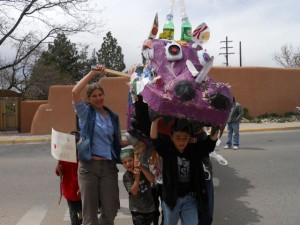 Schoolkids from Penasco joined the Community Parade during the Global Climate Convergence, bringing along the recycled plastic dragon they built!