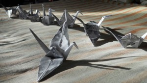 Love-In-Action Taos folded paper cranes designed by Taos member, Paul Gutches.