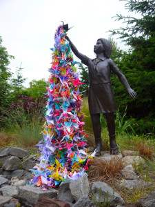 Sadako statue with paper cranes in Japan.