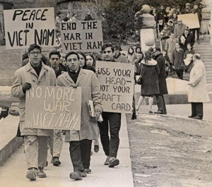 Antiwar protesters in January 1965, uwdigitalcollections - Student protesters marching down Langdon Street, CC BY 2.0